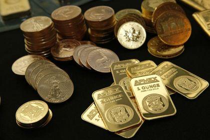 Altın 4 yılın en düşüğüne geriledi - Altın ve gümüş, BOJ'un teşviki artırması ve Fed'in varlık alım programını sonlandırmasının ardından doların güçlenmesi ile 2010'dan bu yana en düşük seviyeye geriledi (11:03'te güncellendi)