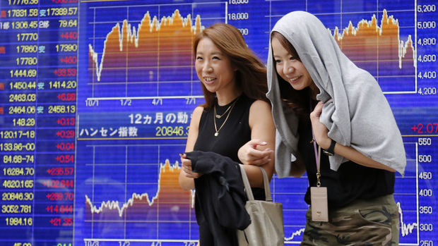 Japonya hisseleri zayıf yen ile yükseldi