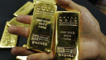 Altın güçlü dolar ile haftayı kayıpla geçmeye yöneldi