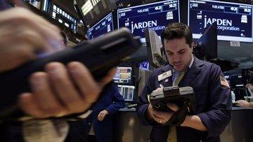 Küresel Piyasalar: Dolar yükseldi, hisseler karışık
