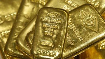 Altın güçlü dolar ve faiz ile düştü