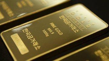 Altın Powell sonrası güçlü dolarla 1 yılın en düşüğüne indi